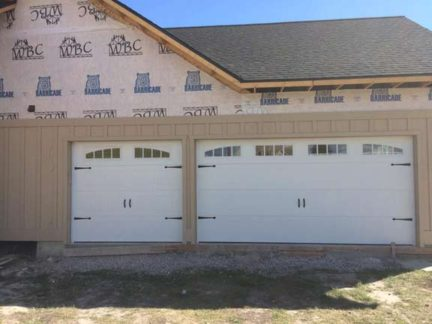New Construction. SteelCraft's. Carriage Craft doors w/deco hinges/handles